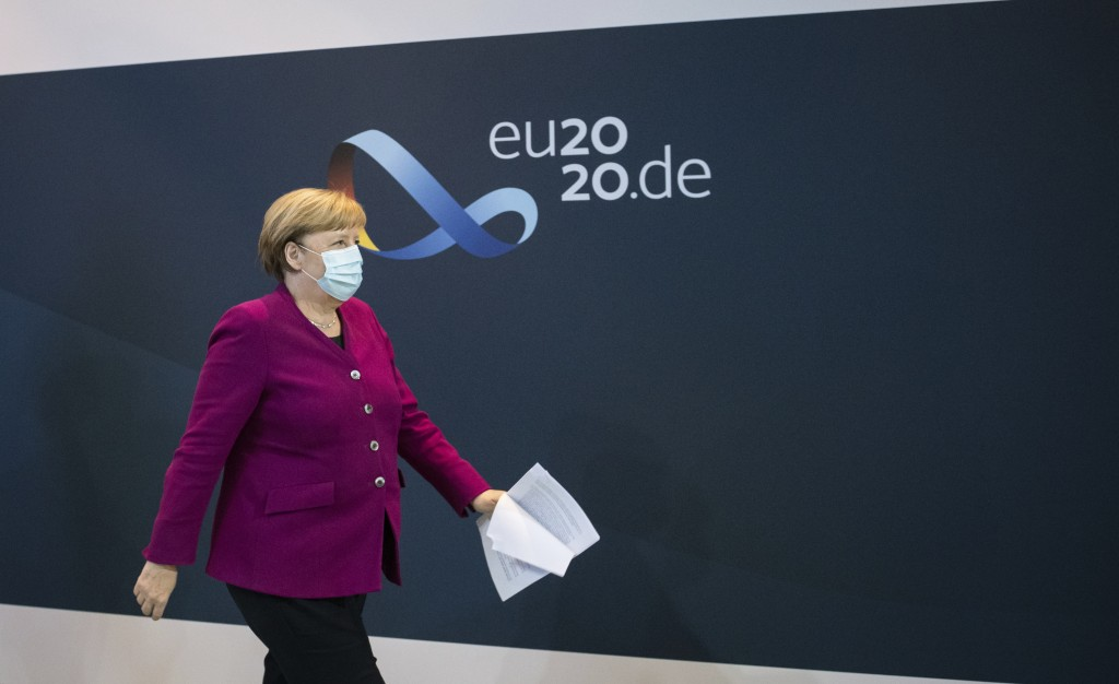 German Chancellor Angela Merkel leaves after a press conference following a meeting of the governors of the German states on the coronavirus situation...