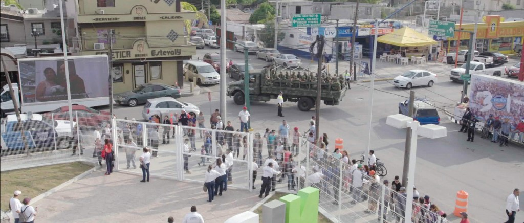 A Mexican military truck with soldiers patrol the baseball stadium in Nuevo Laredo, Mexico, during a 2019 home game of e Tecolotes de los Dos Laredo, ...