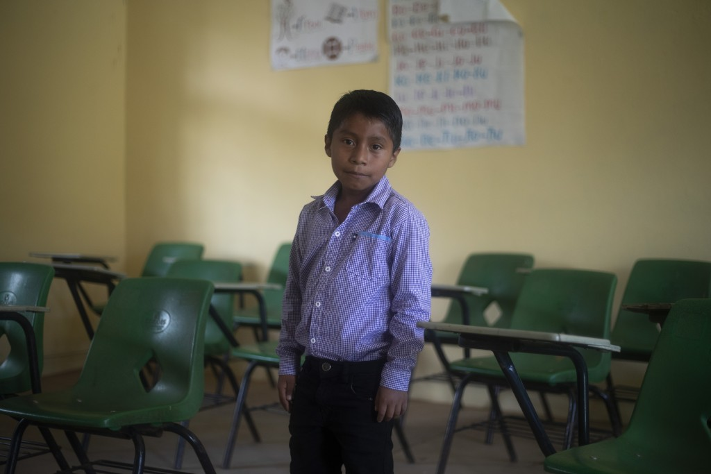 Hector Vasquez poses for a portrait inside his former classroom at the Nuevo Yibeljoj school, closed amid the new coronavirus pandemic in Chiapas stat...