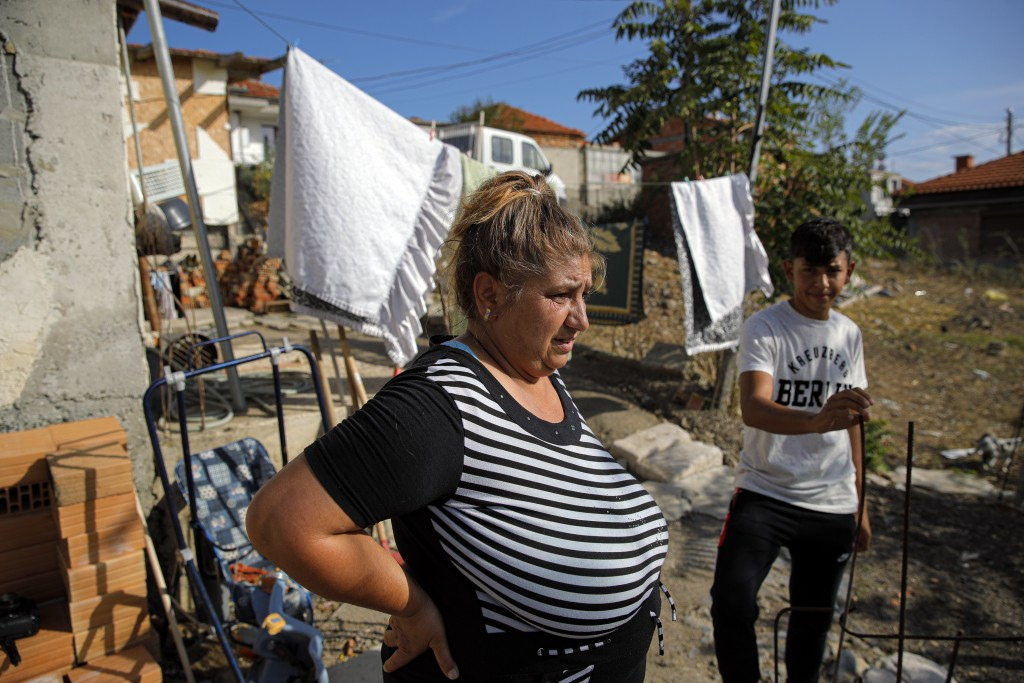 Azime Ali Topchu, 48, a Bulgarian Roma woman, stands in her back yard in a village on the outskirts of Burgas, Bulgaria, Monday, Sept. 28, 2020. Human...