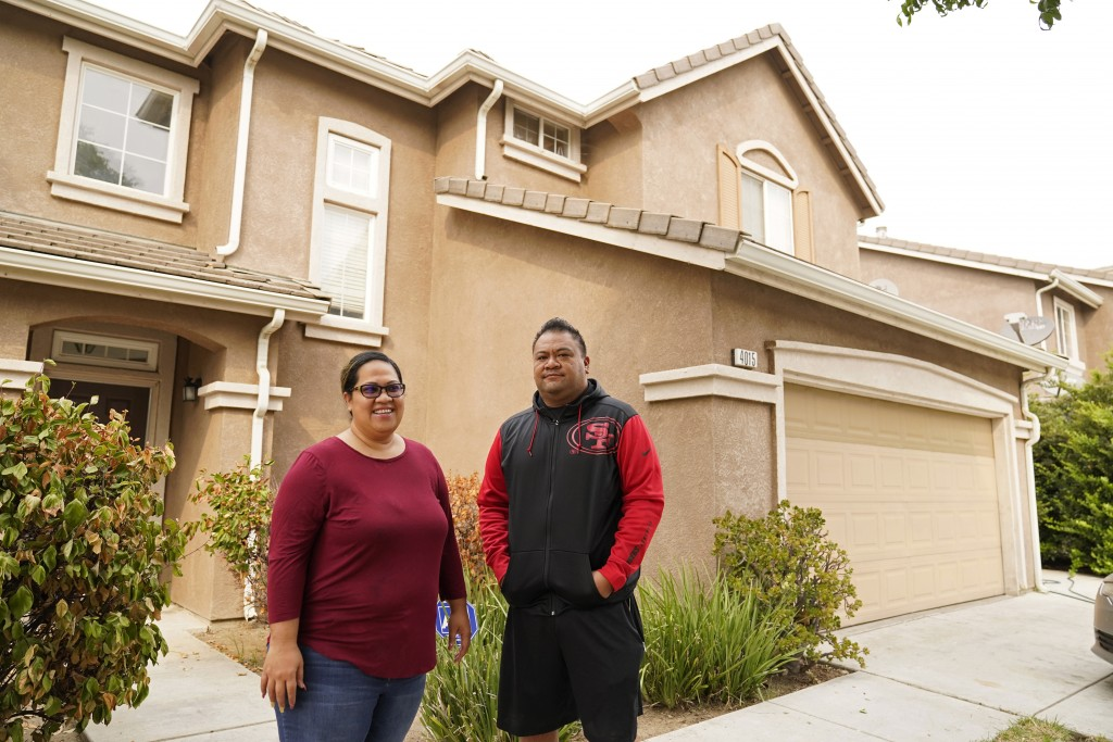 Makerita Iosefo-Va'a and her husband Shaun Va'a stand outside a relative's home where they are temporarily staying in Tracy, Calif., on Oct. 8, 2020. ...