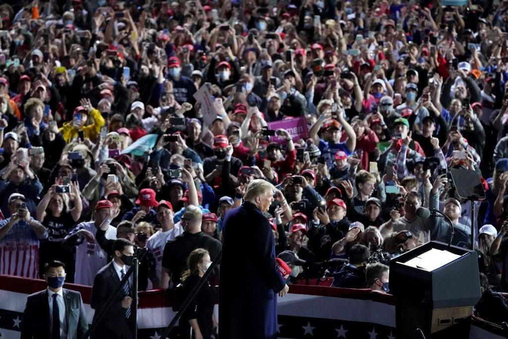 President Donald Trump arrives to speak at a campaign rally at Des Moines International Airport, Wednesday, Oct. 14, 2020, in Des Moines, Iowa. (AP Ph...