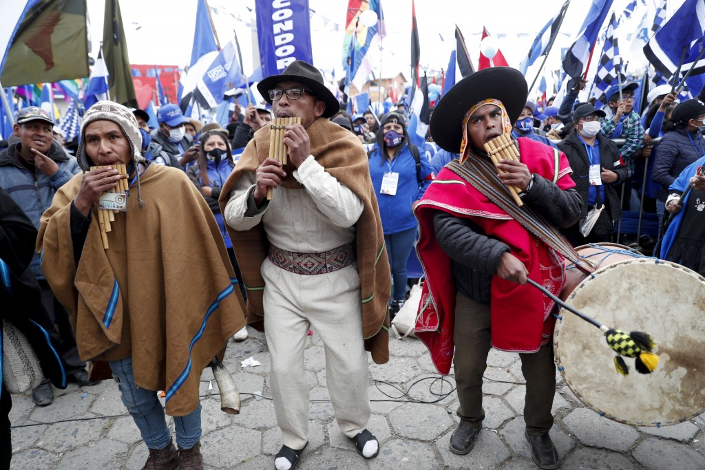 Supporters of Bolivian presidential candidate for the Movement Towards Socialism Party, MAS, Luis Arce, play pan flutes and drums during his closing c...