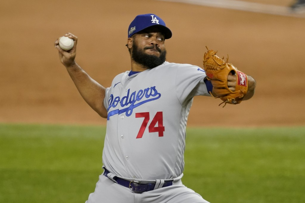 Los Angeles Dodgers relief pitcher Kenley Jansen throws against the Atlanta Braves during the sixth inning in Game 3 of a baseball National League Cha...