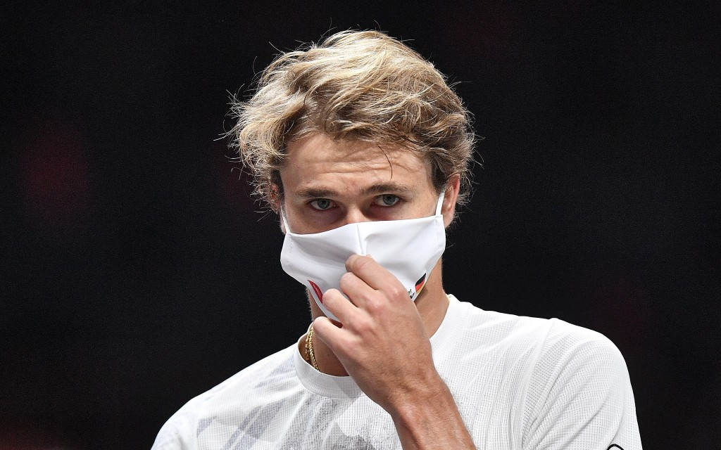 Germany's Alexander Zverev puts on a face mask after his ATP bett1HULKS Indoors tennis match against Spain's Fernando Verdasco in Cologne, Germany, Th...