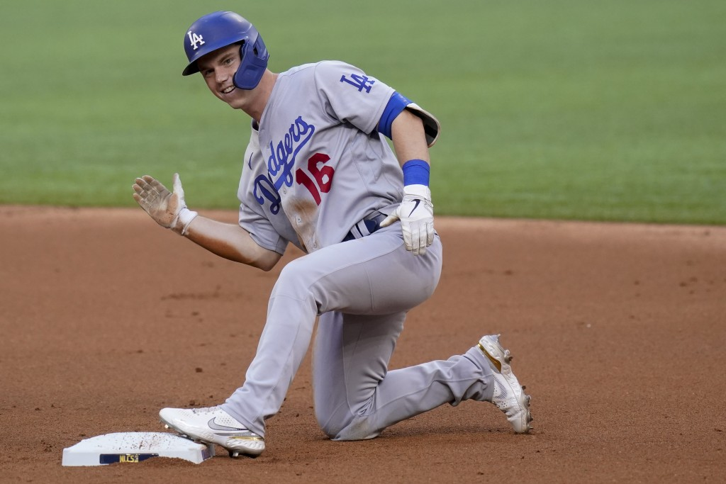 Los Angeles Dodgers' Will Smith is safe at second after a double during the first inning in Game 3 of a baseball National League Championship Series a...
