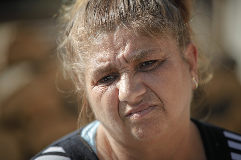 Azime Ali Topchu, 48, a Bulgarian Roma woman, pauses during an interview with the Associated Press in a village on the outskirts of Burgas, Bulgaria, ...