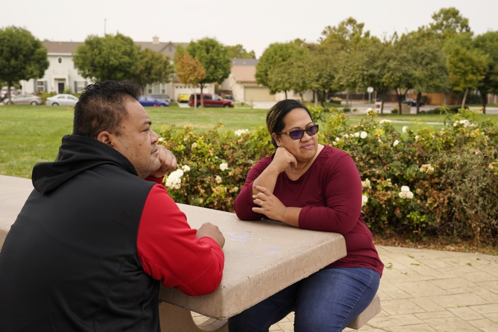 Makerita Iosefo-Va'a and her husband Shaun Va'a sit together in a park near a relative's home where they are temporarily staying in Tracy, Calif., on ...