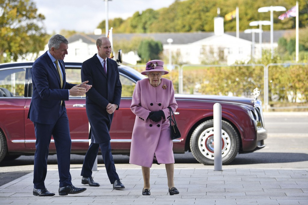 Britain's Queen Elizabeth II and Prince William speak with Chief Executive Gary Aitkenhead during a visit to the Defence Science and Technology Labora...
