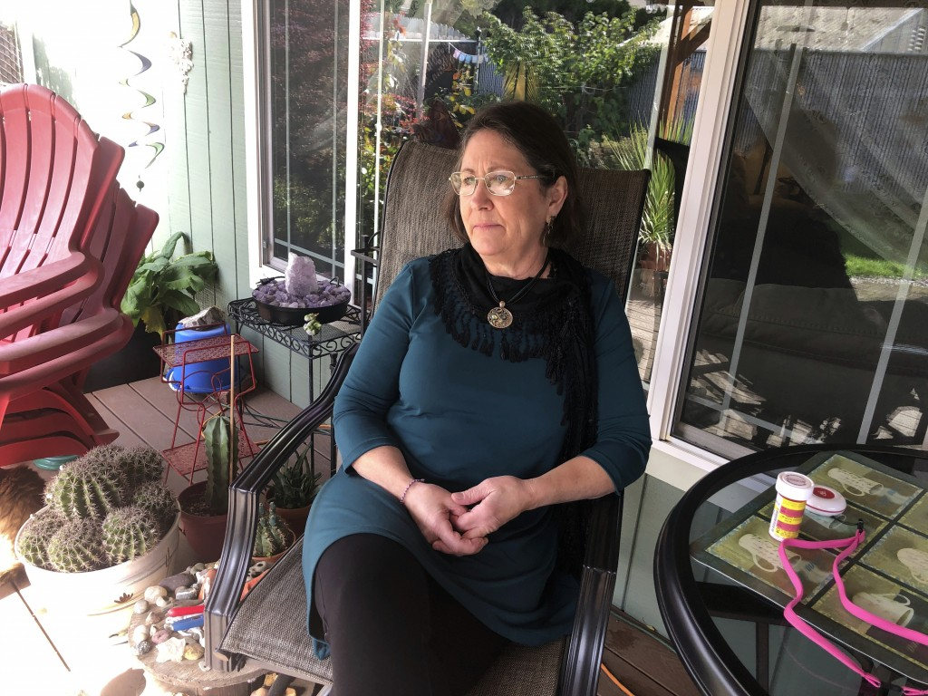 Barbara Trout, who has an asthma disorder, keeps her asthma medicine and a neck alarm next to her on the table, at right, at her home in Keizer, Ore.,...