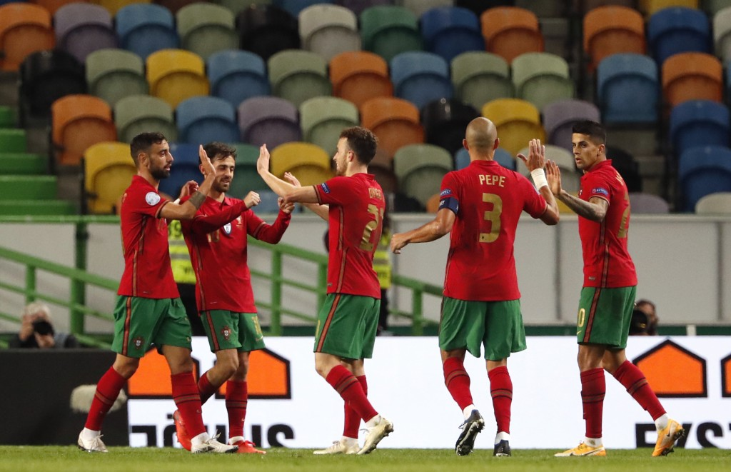 Portugal's Diogo Jota, centre, celebrates with teammates after scoring his side's third goal during the UEFA Nations League soccer match between Portu...