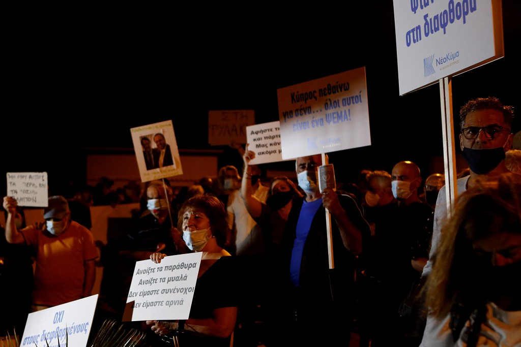 "Demonstrators with placards reading in Greek , second right, ""Cyprus I die for you, they are all a lie"" and on the left, ""Open the windows open the mi..."
