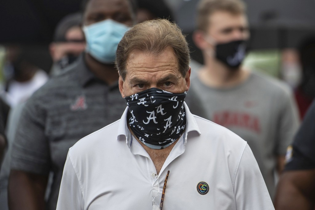 FILE - In this Aug. 31, 2020, file photo, Alabama head football coach Nick Saban leads his team as they march on campus, supporting the Black Lives Ma...