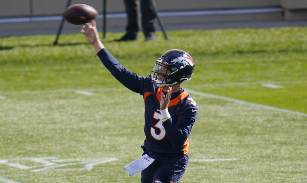 Denver Broncos quarterback Drew Lock warms up before taking part in drills during an NFL football practice Wednesday, Oct. 14, 2020, at the team's hea...