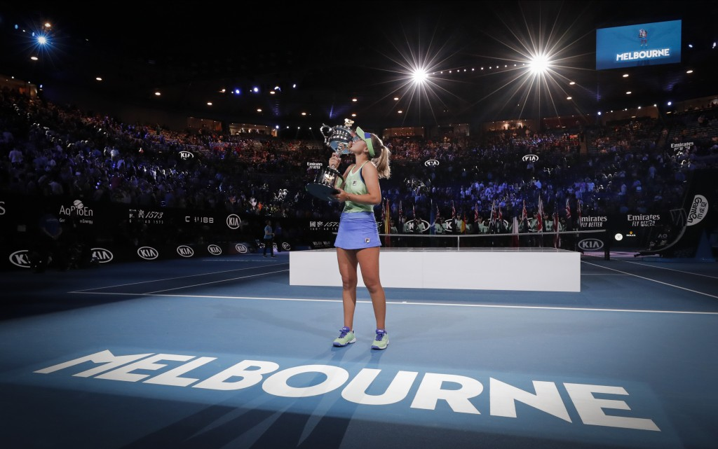 FILE - In this Feb. 1, 2020, file photo, Sofia Kenin, of the United States, kisses her trophy after defeating Spain's Garbine Muguruza in the women's ...