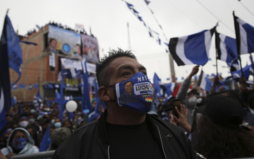 Supporters of Luis Arce, who is running for president for the Movement Towards Socialism Party, MAS, attends Arce's closing campaign rally in El Alto,...