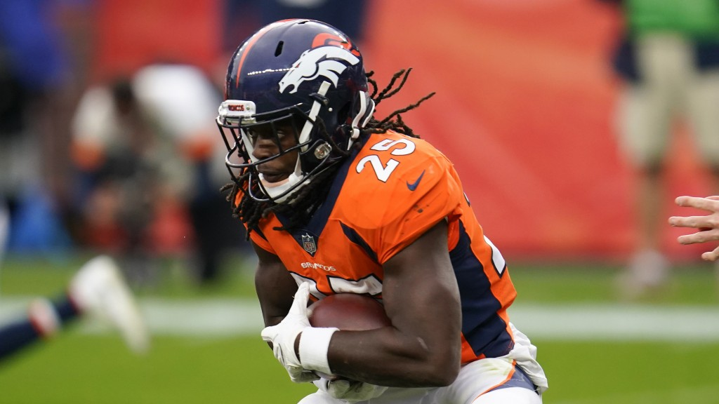 FILE  - In this Sunday, Sept. 27, 2020, file photo, Denver Broncos running back Melvin Gordon runs with the ball during the second half of an NFL foot...