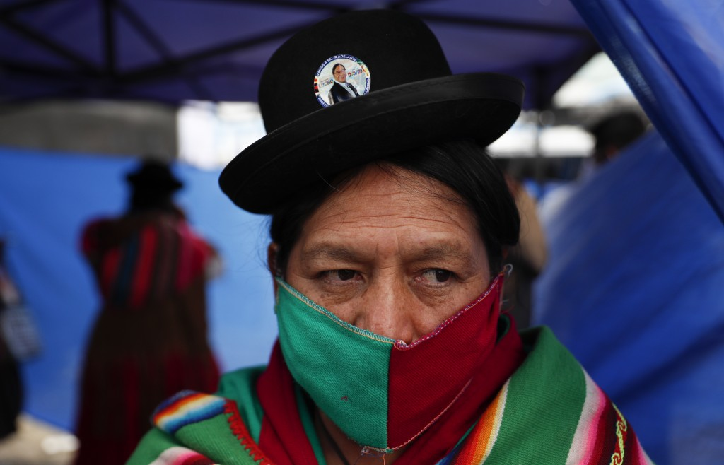 A supporter of Luis Arce, who is running for president for the Movement Towards Socialism Party (MAS) attends Arce's closing campaign rally in El Alto...