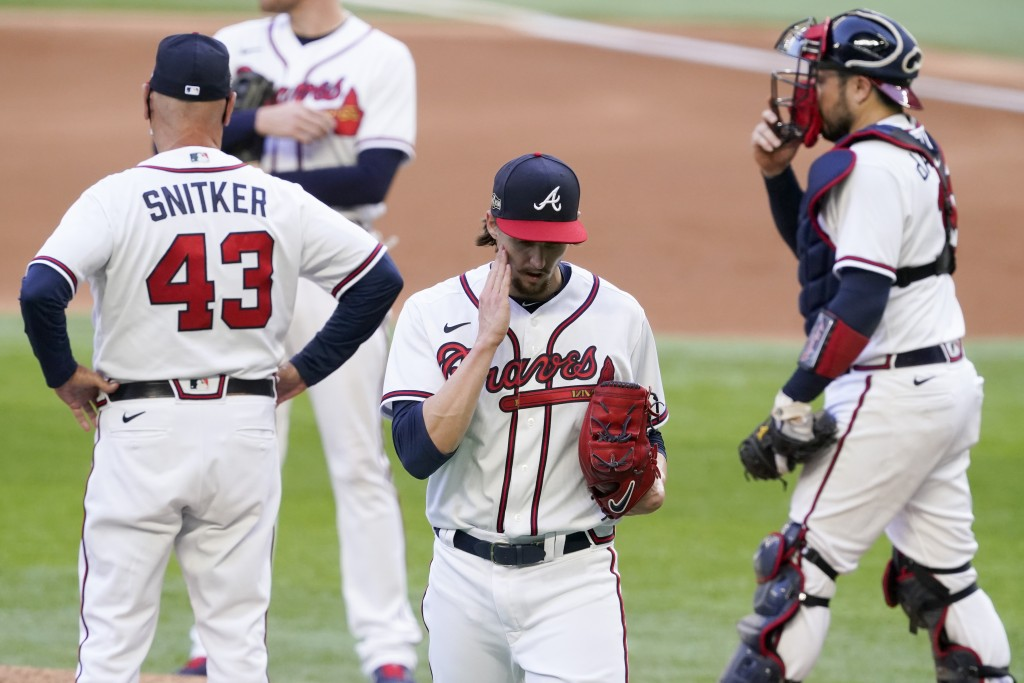 Atlanta Braves starting pitcher Kyle Wright is taken out of the game against the Los Angeles Dodgers during the fourth5 inning in Game 3 of a baseball...