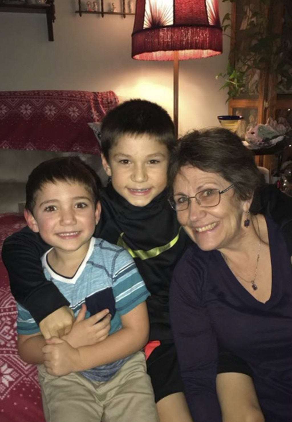In this December 2019 photo, provided by Barbara Trout, she poses with grandsons Grayson, center, and Garrett, left, in Keizer, Ore. Trout, who suffer...