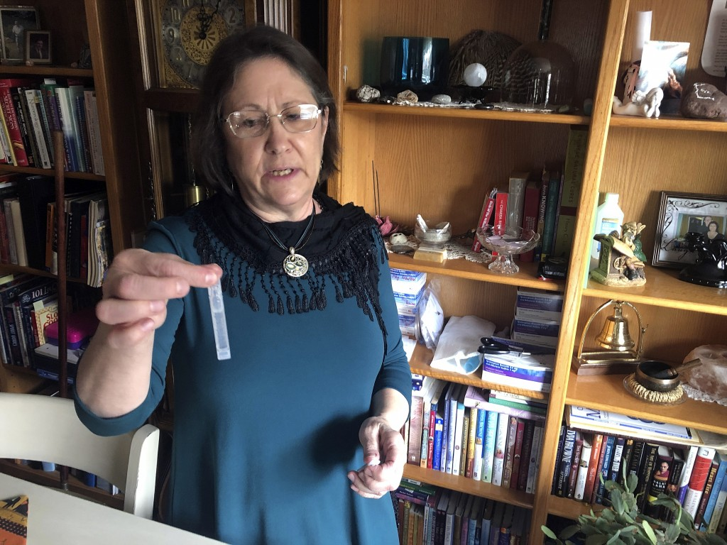 Barbara Trout, who has an asthma disorder, holds a vial of inhalation solution of Ipratropium Bromide and Albuterol Sulfate, prescribed medication at ...