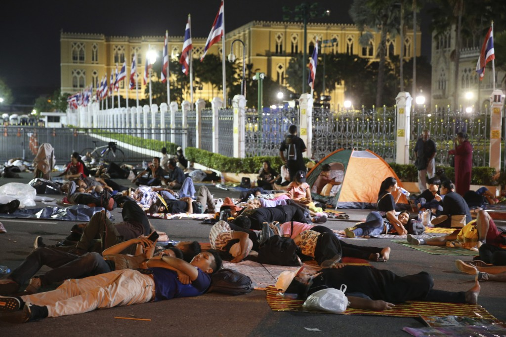 Protesters sleep in front of Government House during a demonstration in Bangkok, Thailand, Thursday, Oct. 15, 2020. Thai police dispersed a group of p...