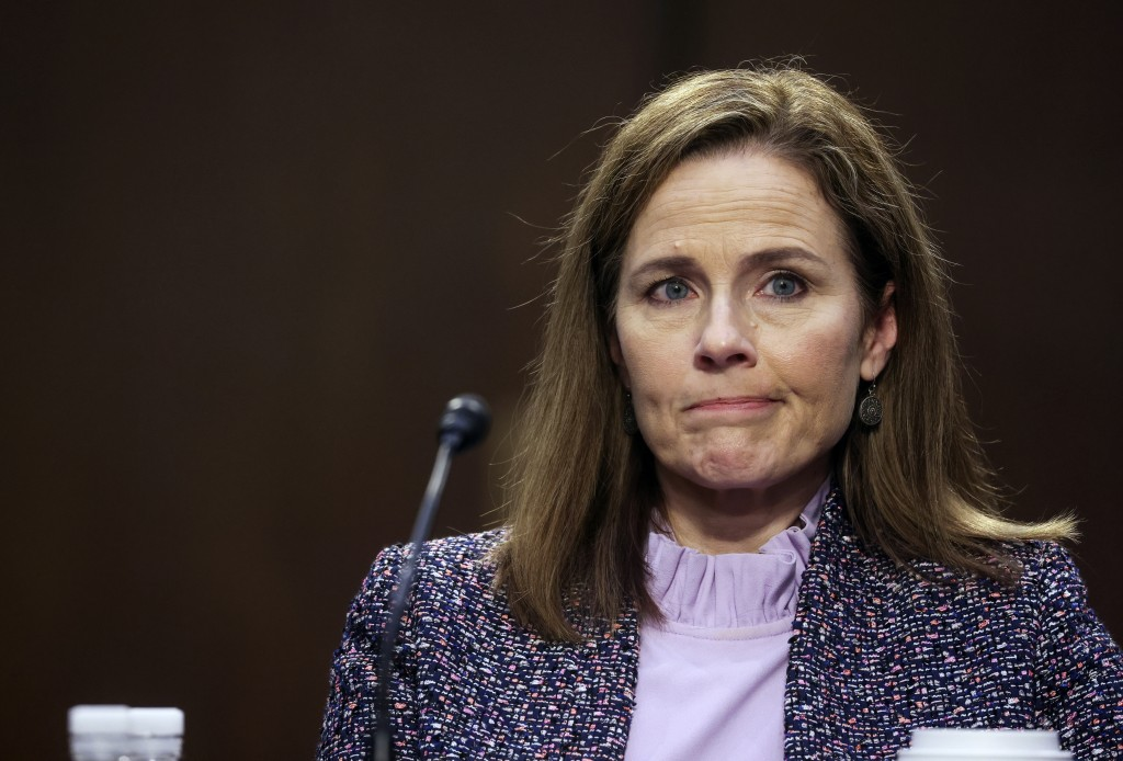 Supreme Court nominee Amy Coney Barrett departs with her husband, Jesse, after the third day of her confirmation hearings before the Senate Judiciary ...