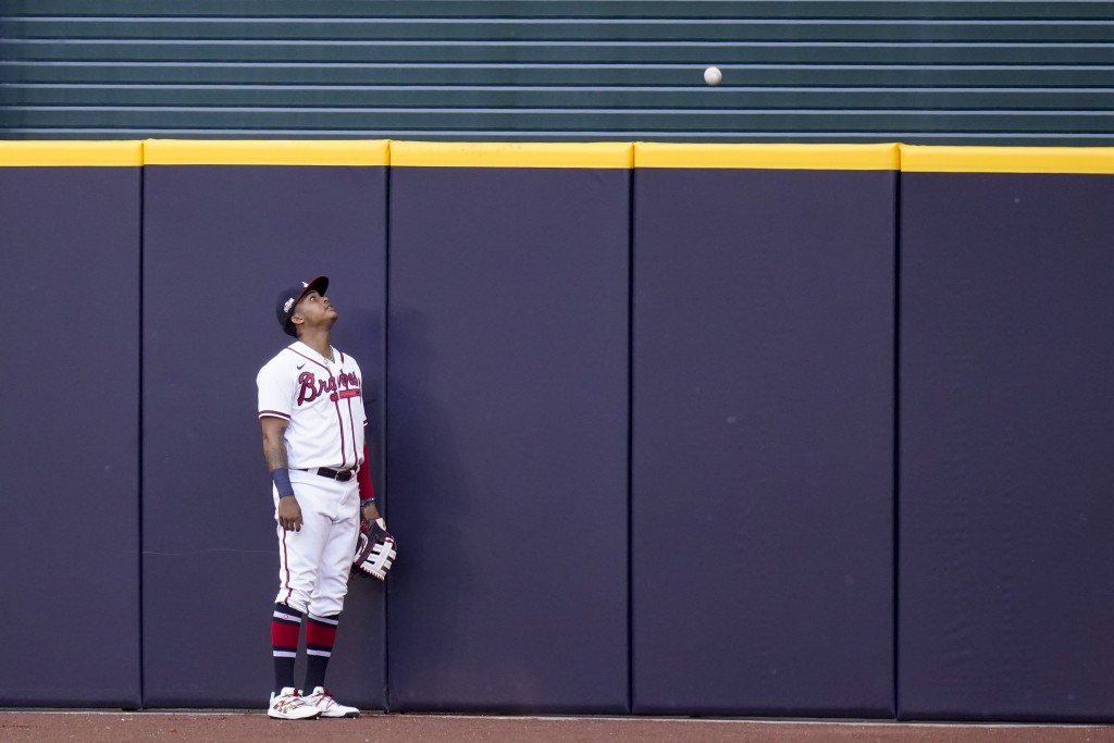 Atlanta Braves center fielder Cristian Pache watches a home run ball by Los Angeles Dodgers Edwin Rios during the first inning in Game 3 of a baseball...