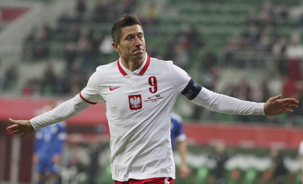 Poland's forward Robert Lewandowski celebrates after scoring a goal during a UEFA Nations League soccer match between Poland and Bosnia and Herzegovin...