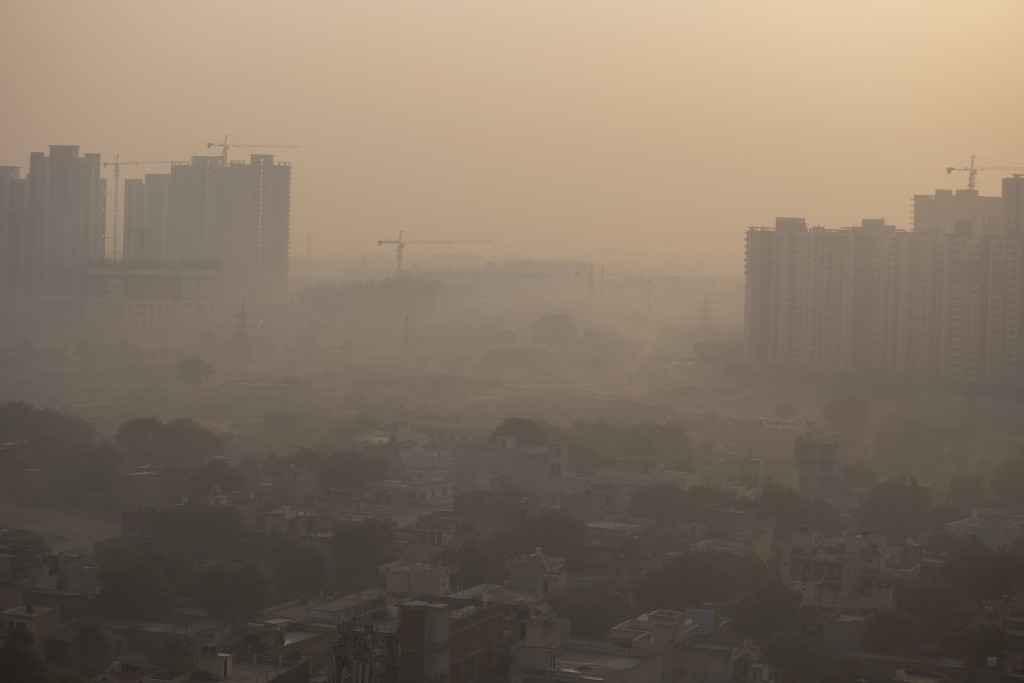 """Morning haze envelops the skyline on the outskirts of New Delhi, India, Friday, Oct. 16, 2020. The Indian capital's air quality levels plunged to """"ver..."""