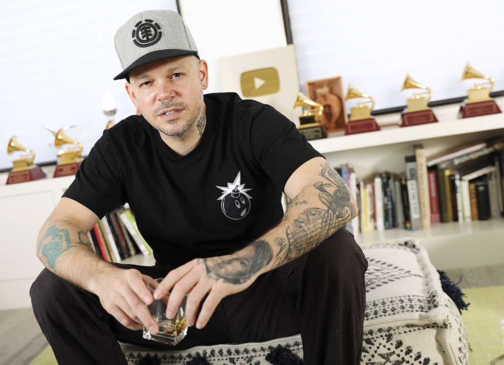FILE - In this Friday, July 12, 2019 photo, rapper, writer, and filmmaker Rene Perez Joglar, know professionally as Residente, poses for a portrait in...