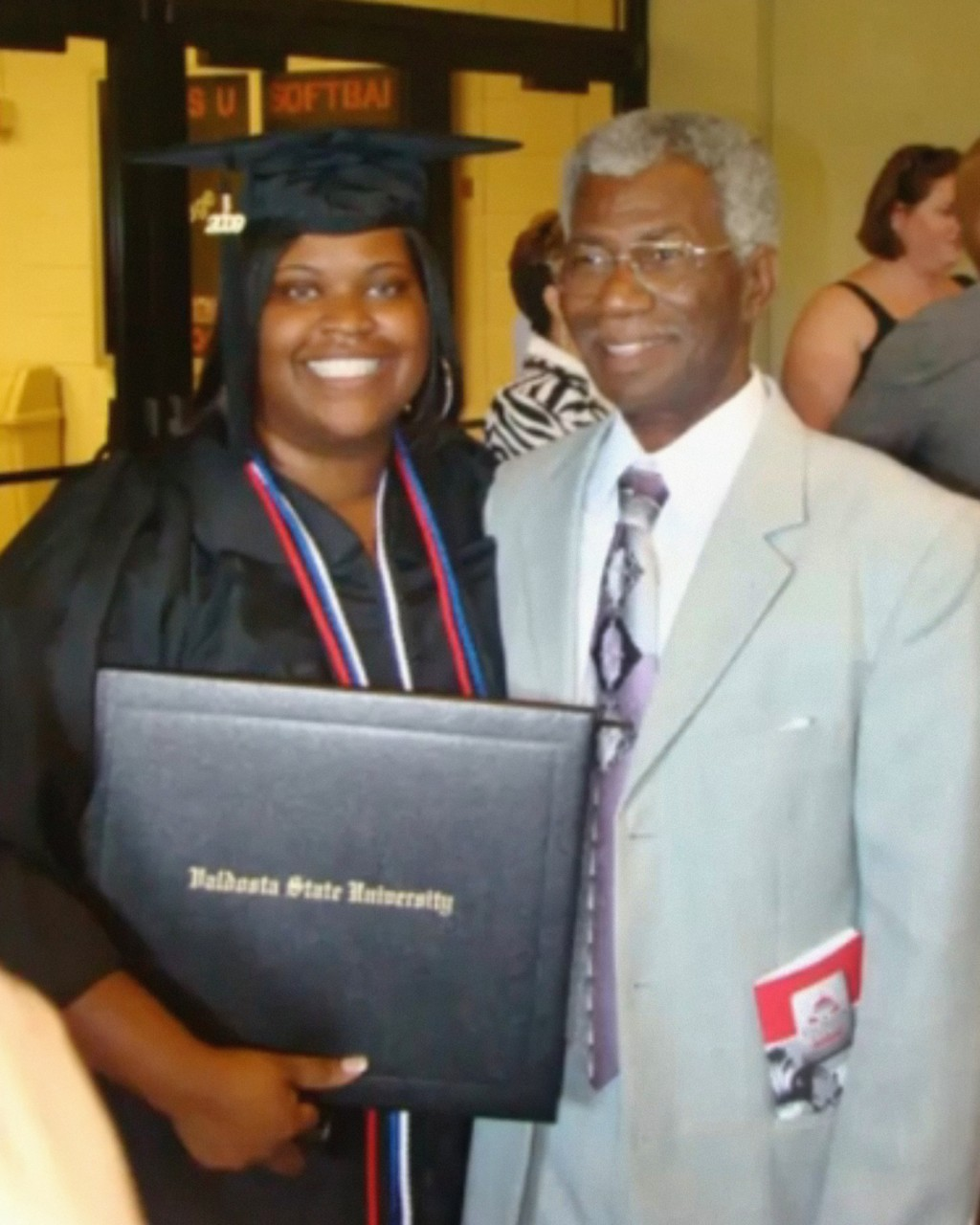 This 2009 photo provided by Tressa Clements shows her daughter, Saferia Johnson, with her grandfather, Lindsey Johnson Sr., during celebrations for Sa...