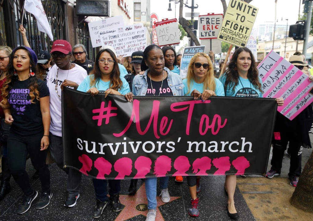 FILE - In this Nov. 1, 2017, file photo, Tarana Burke, founder and leader of the #MeToo movement, marches with others at the #MeToo March in the Holly...