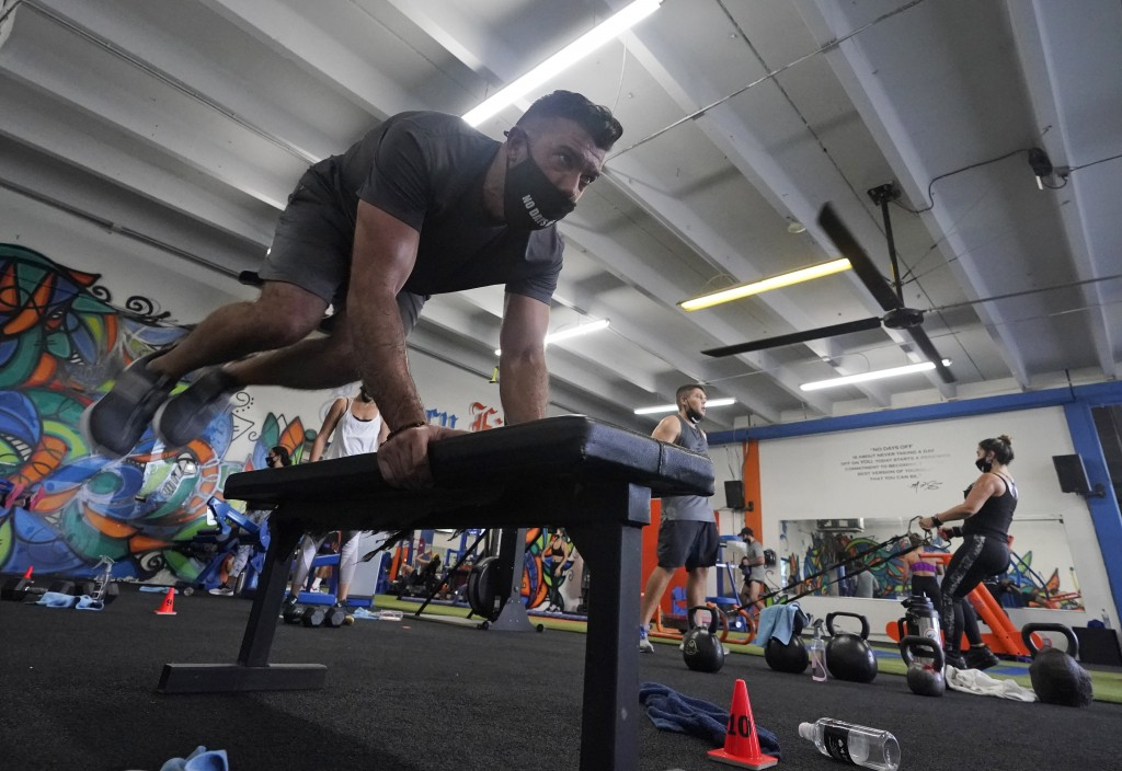 *Jorge Garcia works out, Monday, Aug. 31, 2020, at Legacy Fit in the Wynwood Art District of Miami. As the vast majority of in-person fitness clubs sw...