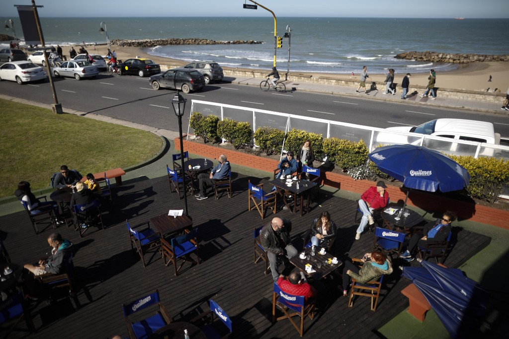 People sit outside at a restaurant during the COVID-19 pandemic in Mar del Plata, Argentina, Saturday, Oct. 10, 2020. Mar del Plata, which at the star...