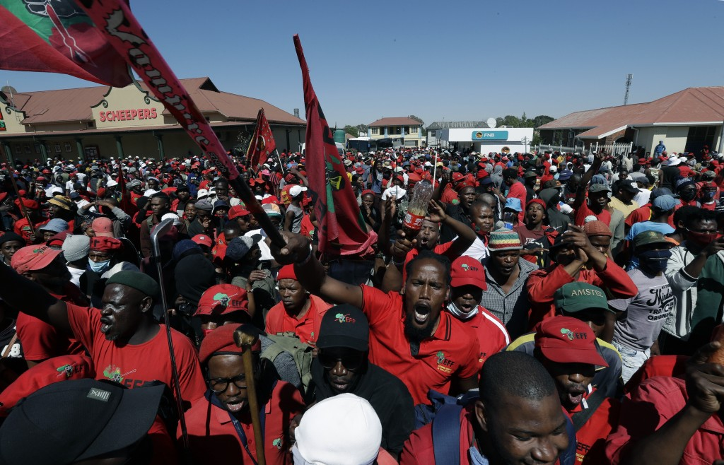 Members of the Economic Freedom Fighters protest outside the magistrates court in Senekal, South Africa, Friday, Oct. 16, 2020 where two suspects were...