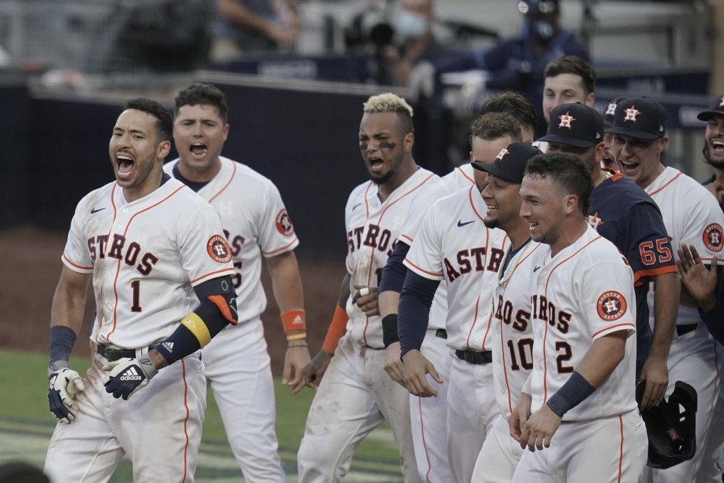 Players celebrate Houston Astros Carlos Correa's (1) walk off home run during the ninth inning in Game 5 of a baseball American League Championship Se...