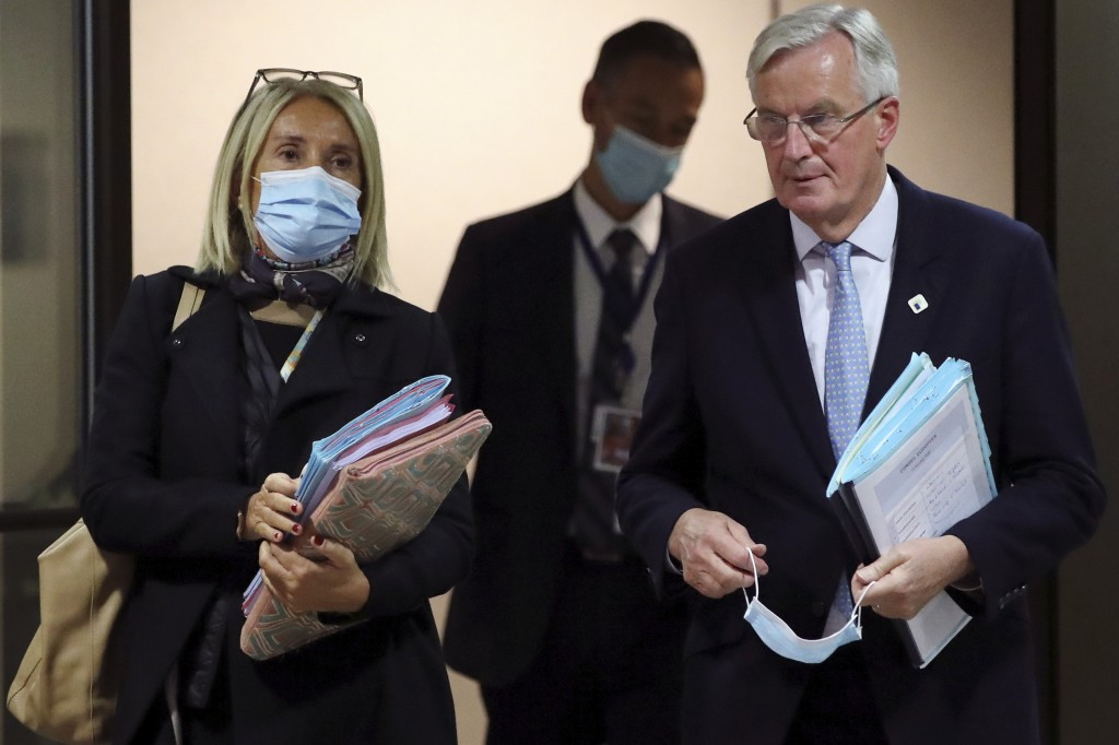 European Commission's Head of Task Force for Relations with the United Kingdom Michel Barnier, right, leaves after addressing a media conference at an...
