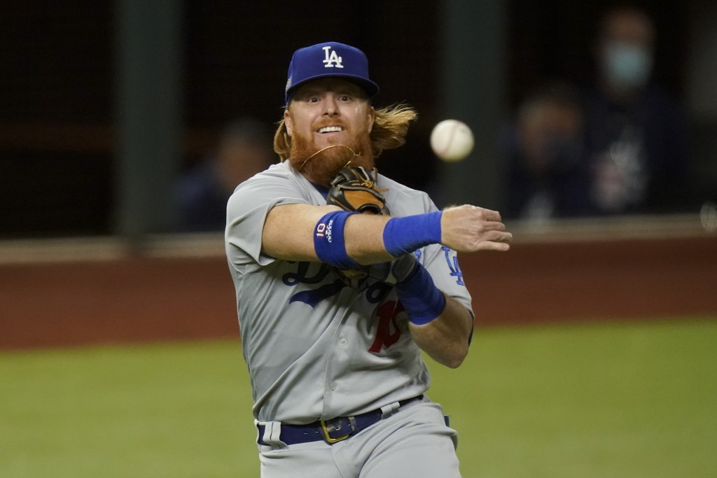 Los Angeles Dodgers third baseman Justin Turner throws out Atlanta Braves' Travis d'Arnaud out at first during the second inning in Game 4 of a baseba...