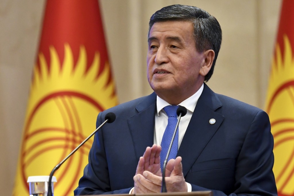 Kyrgyzstan's President Sooronbai Jeenbekov applauds after delivering his speech during an official ceremony of transfer of the power at the Kyrgyzstan...