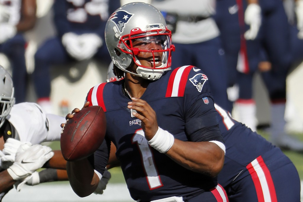 New England Patriots quarterback Cam Newton looks to pass against the Las Vegas Raiders during an NFL football game at Gillette Stadium, Sunday, Sept....