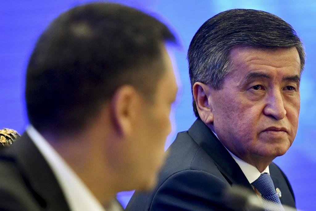 Kyrgyzstan's Prime Minister Sadyr Zhaparov, left, and Kyrgyzstan's President Sooronbai Jeenbekov attend an official transfer of the power ceremony at ...