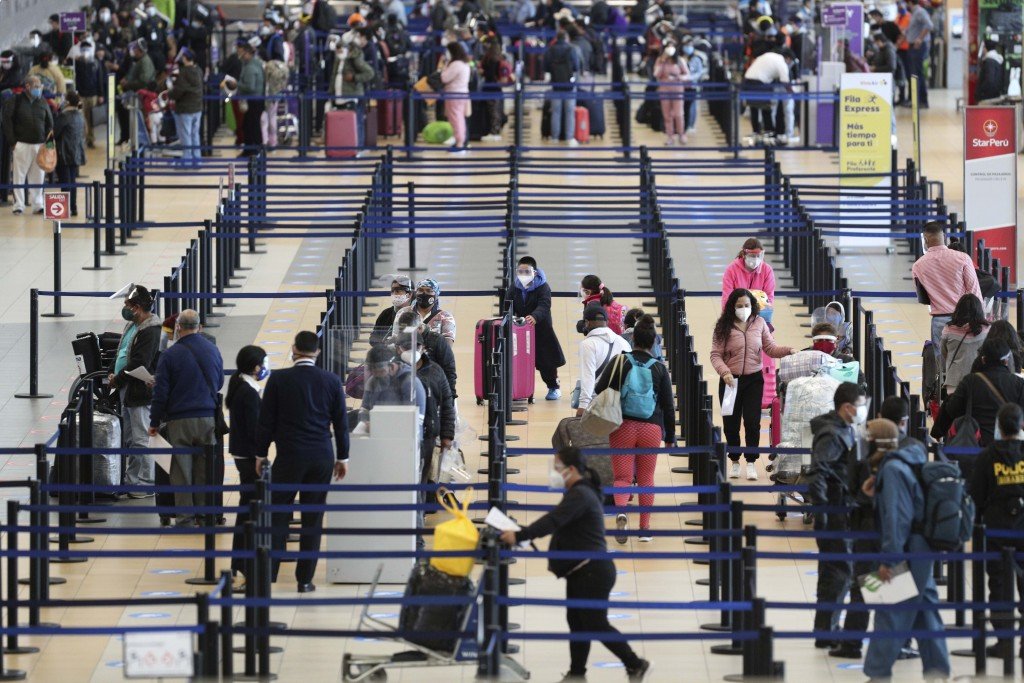 Passengers check-in at the Jorge Chavez International Airport in Callao, Peru, Monday, Oct. 5, 2020. After international flights were halted for more ...