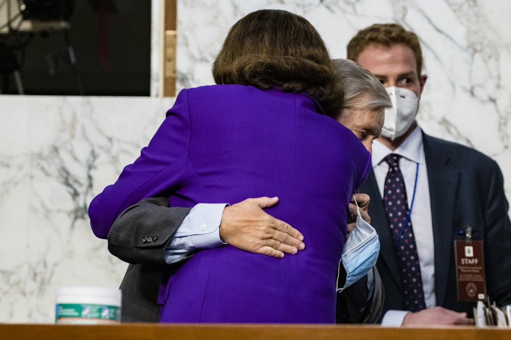 Sen. Lindsey Graham, R-S.C., hugs Sen. Dianne Feinstein, D-Calif., at the close of the confirmation hearing for Supreme Court nominee Amy Coney Barret...