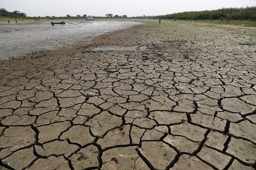 Cracked earth is exposed in the riverbed of the Paraguay River in Chaco-i near Asuncion city, Paraguay, Thursday, Oct. 8, 2020. The Paraguay River rea...