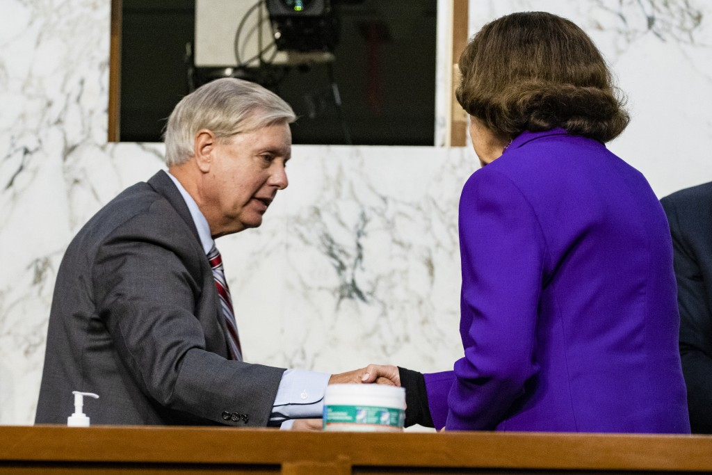 Sen. Lindsey Graham, R-S.C., shakes hands with Sen. Dianne Feinstein, D-Calif., at the close of the confirmation hearing for Supreme Court nominee Amy...