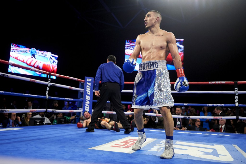 FILE  - In this Feb. 2, 2019, file photo, Teofimo Lopez walks away after defeating Diego Magdaleno during a lightweight boxing match in Frisco, Texas....