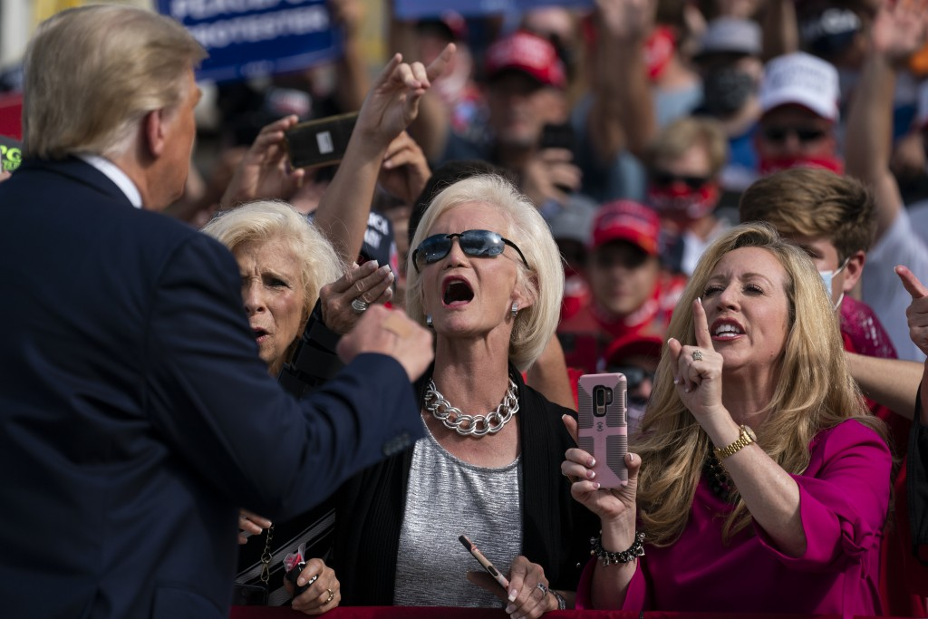 Supporters of President Donald Trump cheer as he walks off stage after speaking at a campaign rally at Pitt-Greenville Airport, Thursday, Oct. 15, 202...