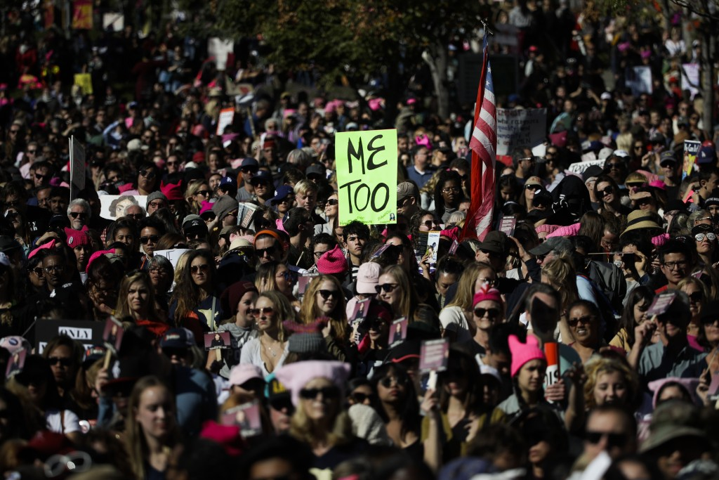 FILE - In this Jan. 20, 2018, file photo, protesters gather at the Grand Park in Los Angeles for a Women's March against sexual violence and the polic...