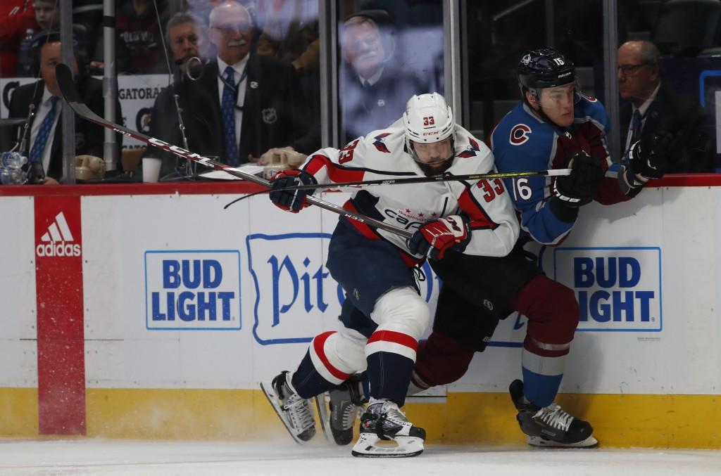 Then-Washington Capitals defenseman Radko Gudas (33) checks Colorado Avalanche defenseman Nikita Zadorov (16) in the first period of an NHL hockey gam...